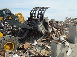 Scrap Handling Grapple Buckets - Dymax Inc